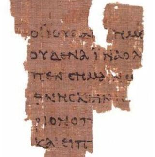 Rylands Library Papyrus P52, recto, part of the Rylands Papyri collection. Source: wikipedia commons.